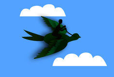 Man flying on top of a bird Stock Images