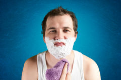 Man with foam on the face Royalty Free Stock Photo