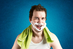 Man with foam on the face. Smiling Royalty Free Stock Photography
