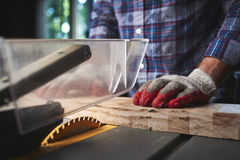 A man using a table saw Royalty Free Stock Photos