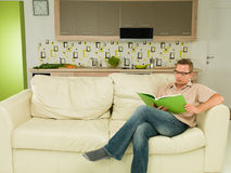 Man focused on reading Stock Image