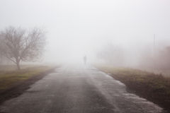Man in fog Royalty Free Stock Image