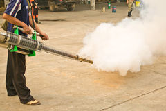 Man fogging chemical to anti mosquitos Stock Photography