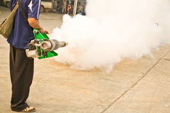 Man fogging chemical to anti mosquitos Royalty Free Stock Photography
