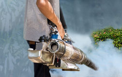 Man fogging mosquito to prevent of dengue fever Royalty Free Stock Images
