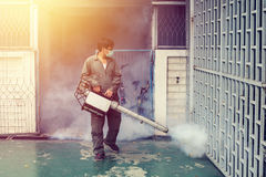 The man fogging to eliminate mosquito for prevent spread dengue fever Stock Image