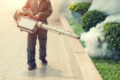 The man fogging to eliminate mosquito for prevent spread dengue fever Royalty Free Stock Photos