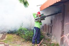 Man Fogging to prevent spread of dengue fever in thailand Stock Photo