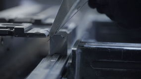 Man fold sheet metal at workshop. Modern tool in heavy industry. Dangerous job. High precision manufacture of steel. Fold sheet metal at workshop. Modern tool in stock footage