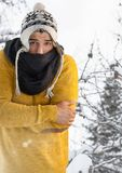 Man with folded arms and hat in snow fores. Digital composite of Man with folded arms and hat in snow fores Royalty Free Stock Photography