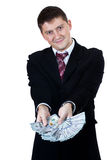 Man folded dollar like a fan and shows them Royalty Free Stock Photos