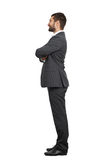 Man with folded hands on his chest. Sideview of smiley businessman with folded hands on his chest. isolated on white background Royalty Free Stock Images