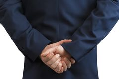 Businessman standing with folded hands behind the back. Man with folded hands in to the lock Royalty Free Stock Images