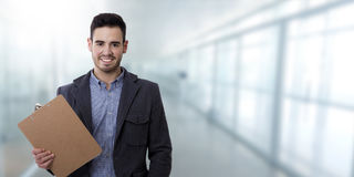 Man with the folder documents. And space for text or ads stock photography