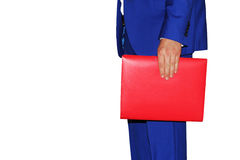 Man with a folder on a white background. A man in a blue suit is holding a red folder Royalty Free Stock Images