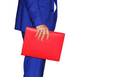Man with a folder on a white background. A man in a blue suit is holding a red folder Stock Photos