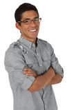 Man folding his arms smiling. College age man folding arms and smiling Royalty Free Stock Image