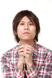 Man folding his hands in prayer Royalty Free Stock Photo