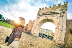 Man following beloved woman on autumn vacation - Fun concept royalty free stock photography