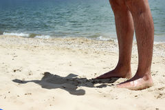 Man foot on beach Royalty Free Stock Images