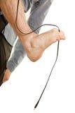 Man foot having cable between toes. Orthopaedist exercises, feet rehabilitation concept. Man foot having cable between toes, isolated Stock Photo