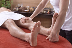 Man at foot massage in a original thai spa Royalty Free Stock Images