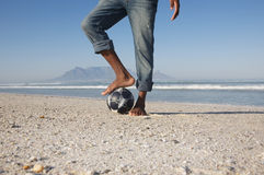 Man With Foot On Soccer Ball At Beach Royalty Free Stock Photos