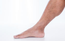 Man foot on white background. Men foot on white background Royalty Free Stock Photography