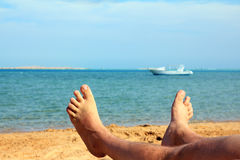 Man foots on beach Royalty Free Stock Images