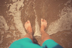 Man foots at seashore Royalty Free Stock Photos