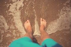 Man foots at seashore Royalty Free Stock Photos