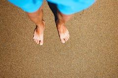 Man foots at seashore Royalty Free Stock Images