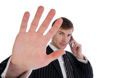 Man forbids. Businessman speaking on mobile phone gesture of hand forbids to remove isolated on white background stock photo
