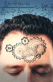 Man forehead with painted gears at equations background Royalty Free Stock Photo