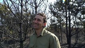 Man in forest smiling, optimist stock footage