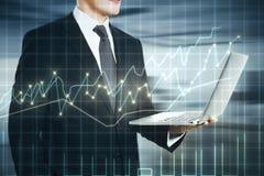 Man with forex laptop multiexposure Stock Photography