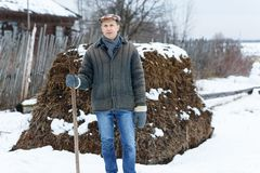 Man with fork in  heap of manure Stock Photos