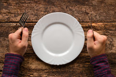 Man with a fork and knife in his hand waiting for your meal Stock Images