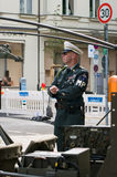 A man in the form of a military police. BERLIN - MAY 28: A man in the form of military police, the exhibition 125 car history - 125 years of history Royalty Free Stock Photo