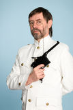 Man in form officer with a gun Royalty Free Stock Photo