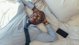 Businessman relaxing on bed Stock Photo