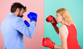 Man formal suit and athletic woman boxing fight. Couple in love competing in boxing. Female and male boxers fighting in. Man formal suit and athletic women royalty free stock photography