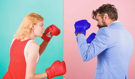 Man formal suit and athletic woman boxing fight. Couple in love competing in boxing. Female and male boxers fighting in. Man formal suit and athletic women royalty free stock image