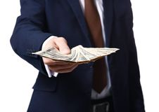 Man in formal suit holding money on white background. Closeup Stock Image