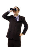 Man in formal suit look into binoculars Royalty Free Stock Image