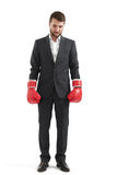 Man in formal wear and boxing gloves Stock Images