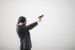 Man in formal wear with gun Royalty Free Stock Photos