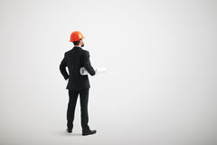 Man in a formal wear and in a hard hat holding blueprints Stock Photography