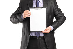 Man in formal wear holding a clipboard Royalty Free Stock Photos