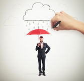 Man in formal wear holding umbrella Stock Photography